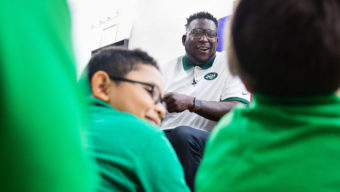 Jarvis Jenkins reads to kids with Barbershop Books during a visit to International Hair Studios in Harlem, NY on September 27, 2016. (Photo by Sam Maller/The Players' Tribune)
