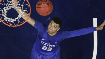Kentucky's Jamal Murray (23) looks up at a shot by a Texas A&M player during an NCAA college basketball game in the championship of the Southeastern Conference tournament in Nashville, Tenn., Sunday, March 13, 2016. Kentucky won 82-77 in overtime. (AP Photo/Mark Humphrey)