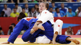 Marti Malloy of the United States, right, and Corina Caprioriu of Romania during the women's 57-kg judo competition at the 2012 Summer Olympics, Monday, July 30, 2012, in London. (AP Photo/Paul Sancya)