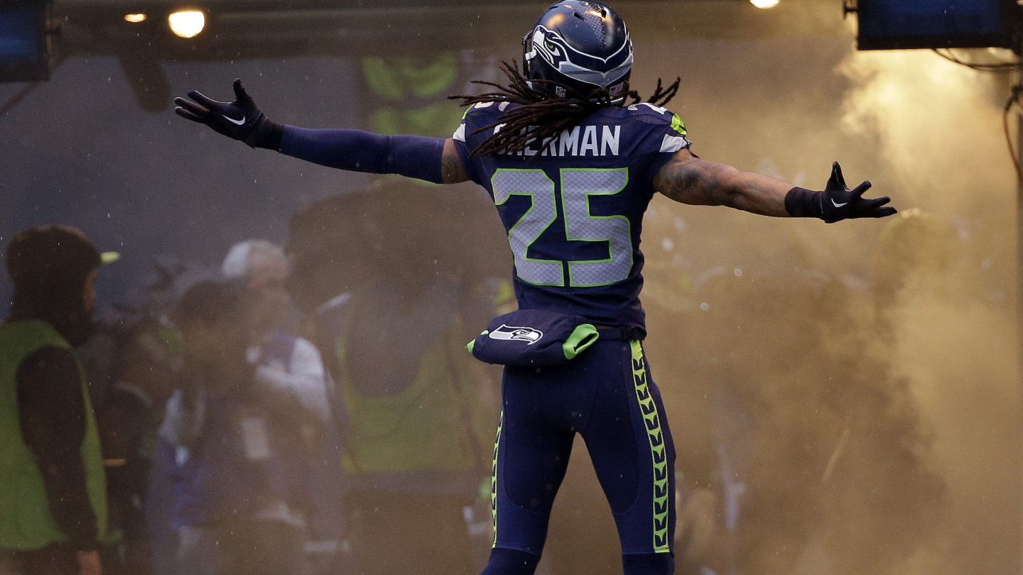 Seattle Seahawks' Richard Sherman opens his arms as he is introduced before the NFL football NFC Championship game against the Green Bay Packers Sunday, Jan. 18, 2015, in Seattle. (AP Photo/David J. Phillip)