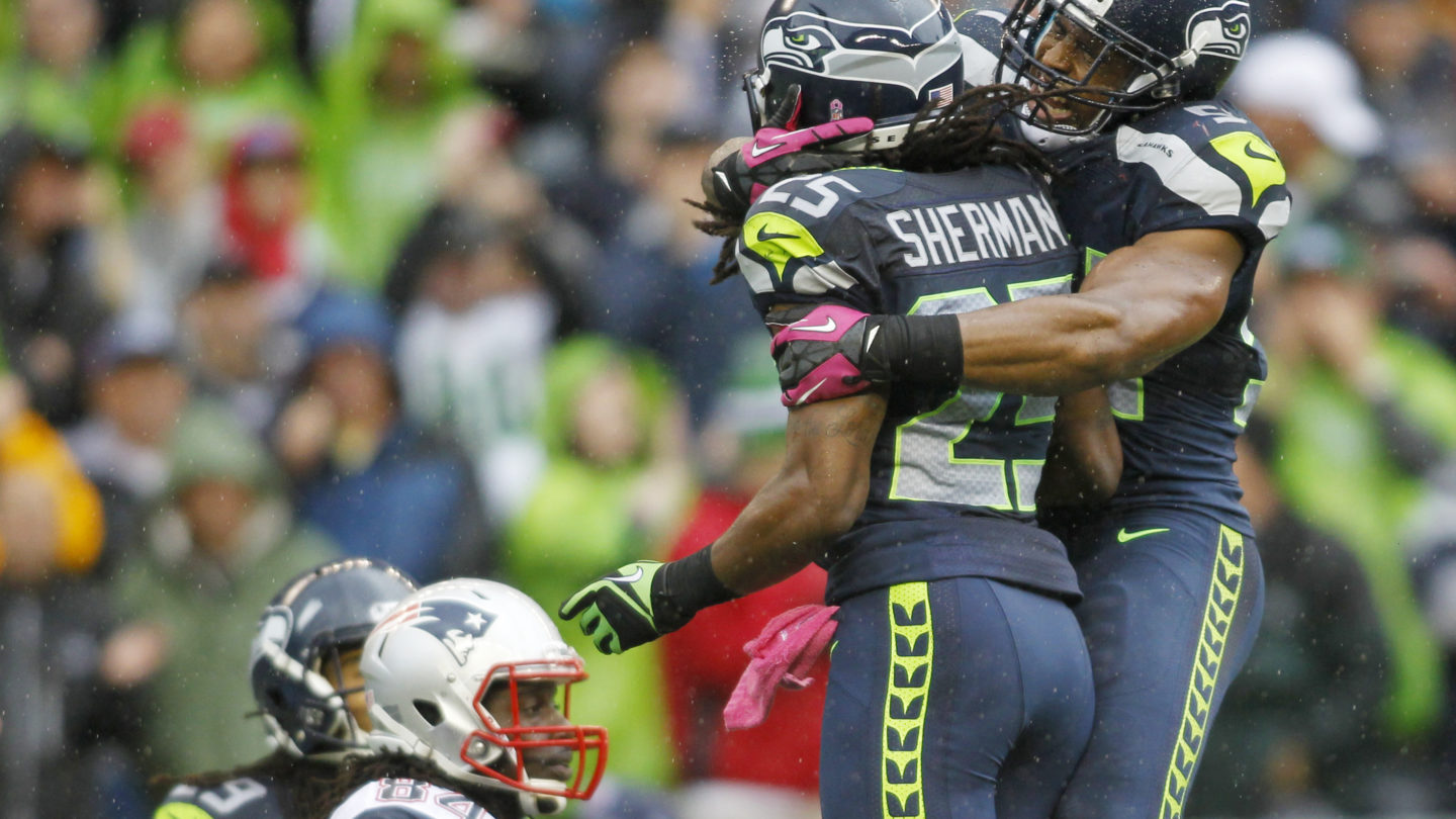 Seattle Seahawks' Bobby Wagner, right, celebrates with Seahawks' Richard Sherman (25) after Sherman intercepted a pass intended for New England Patriots wide receiver Deion Branch (84) in the second half of an NFL football game, Sunday, Oct. 14, 2012, in Seattle. (AP Photo/John Froschauer)