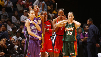 WASHINGTON DC - JULY 15:  The Western Conference WNBA All-Stars, Ticha Penicheiro, Lisa Leslie, Sheryl Swoopes, Tina Thompson and Sue Bird await the start of the second half during the WNBA All-Star game July 15, 2002 in Washington D.C at the MCI Center.  NOTE TO USER: User expressly acknowledges  and agrees that, by downloading and or using this  photograph, User is consenting to the terms and conditions of the Getty Images License Agreement. Mandatory copyright notice: Copyright WNBAE 2002 (Photo by Mitchell Layton/WNBAE/Getty Images)