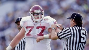 1 Jan 1999:  Brandon Burlsworth #77 of the Arkansas Razorbacks talks to an official during the Florida Citrus Bowl Game against the Michigan Wolverines at the Citrus Bowl in Orlando, Florida. The Wolverines defeated the Razorbacks 45-31. Mandatory Credit: Andy Lyons  /Allsport