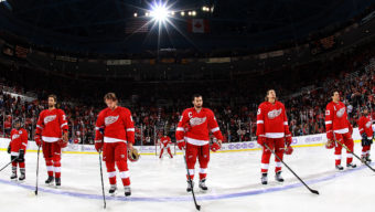 DETROIT, MI - OCTOBER 23:  Kyle Quincey #27, Justin Abdelkader #8, Henrik Zetterberg #40, Danny DeKeyser #65 and Pavel Datsyuk #13 of the Detroit Red Wings line up for the national anthem during a NHL game against the Pittsburgh Penguins on October 23, 2014 at Joe Louis Arena in Detroit, Michigan. (Dave Reginek/NHLI via Getty Images)