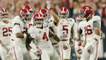 GLENDALE, AZ - JANUARY 11:  Eddie Jackson #4 of the Alabama Crimson Tide celebrates with his teammates after intercepting a ball in the second quarter thrown by Deshaun Watson #4 of the Clemson Tigers during the 2016 College Football Playoff National Championship Game at University of Phoenix Stadium on January 11, 2016 in Glendale, Arizona.  (Photo by Kevin C. Cox/Getty Images)