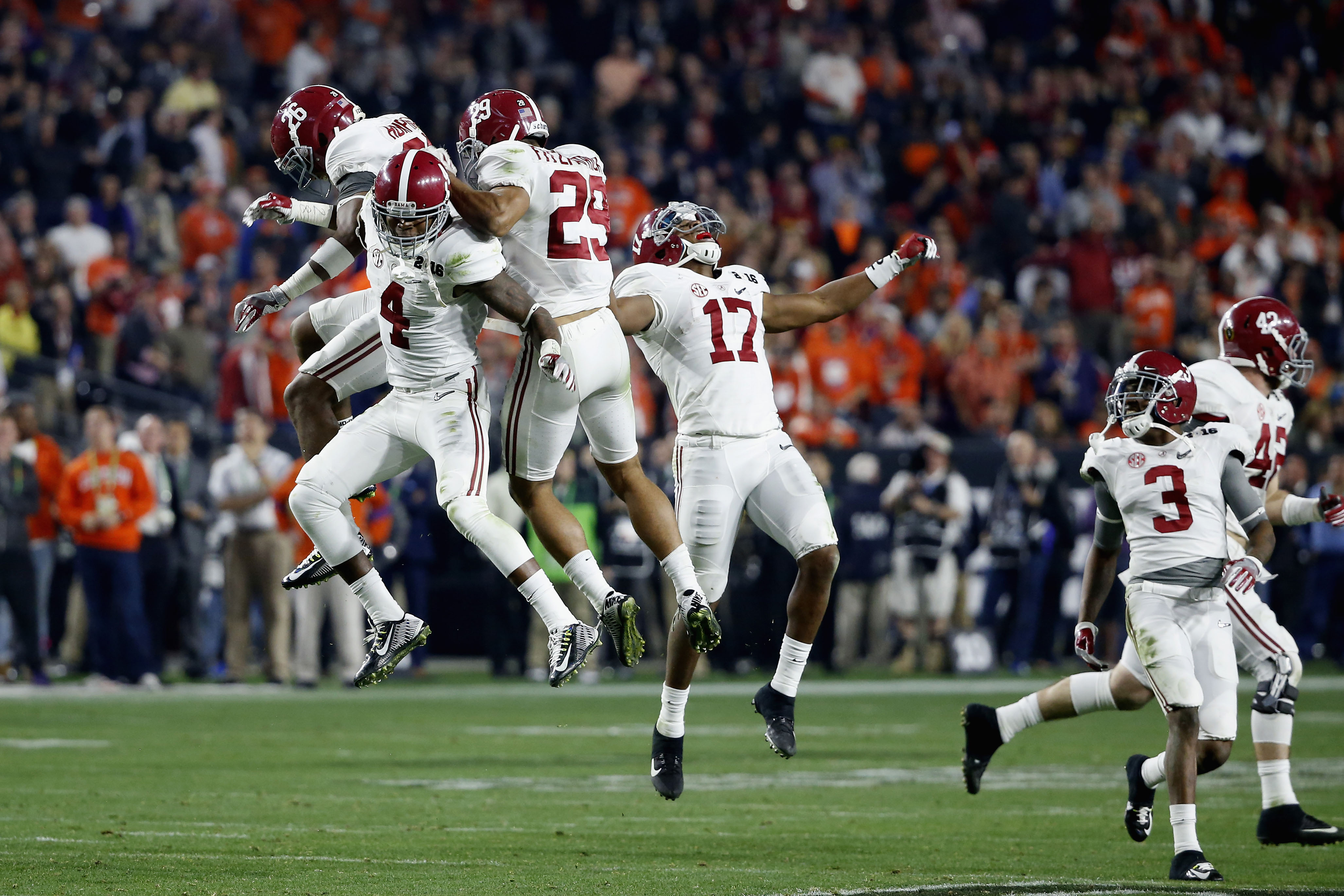 GLENDALE, AZ - JANUARY 11: Eddie Jackson #4 of the Alabama Crimson Tide celebrates with his teammates after a play against the Clemson Tigers during the 2016 College Football Playoff National Championship Game at University of Phoenix Stadium on January 11, 2016 in Glendale, Arizona. (Photo by Sean M. Haffey/Getty Images)
