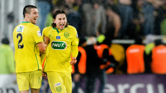 Nantes' US midfielder Alejandro Bedoya (R) and Nantes' French defender Leo Dubois (L) celebrate after winning the French Cup round of 16 football match between Bordeaux and Nantes on February 10, 2016 at the Matmut Atlantique stadium in Bordeaux, southwestern France.  AFP PHOTO / NICOLAS TUCAT / AFP / NICOLAS TUCAT        (Photo credit should read NICOLAS TUCAT/AFP/Getty Images)