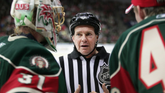 GOTHENBURG, SWEDEN - OCTOBER 2: NHL Referee Kerry Fraser explains one of his calls to Ari Ahonen #31 and Johan Holmqvist #40 of the Frolunda Indians during a stoppage in play against  the Ottawa Senators at Scandinavium Arena on October 2, 2008 in Gothenburg, Sweden. (Photo by Andre Ringuette/NHLI via Getty Images)