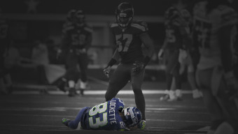 Seattle Seahawks' Mike Morgan (57) looks down at wide receiver Ricardo Lockette (83) who lays on the ground after suffering an unknown injury in the first half of an NFL football game against the Dallas Cowboys  Sunday, Nov. 1, 2015, in Arlington, Texas. (AP Photo/Brandon Wade)