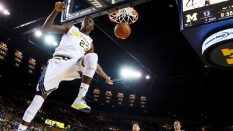 Jan 10, 2015; Ann Arbor, MI, USA; Michigan Wolverines guard Caris LeVert (23) dunks in the first half against the Minnesota Golden Gophers at Crisler Center. Mandatory Credit: Rick Osentoski-USA TODAY Sports