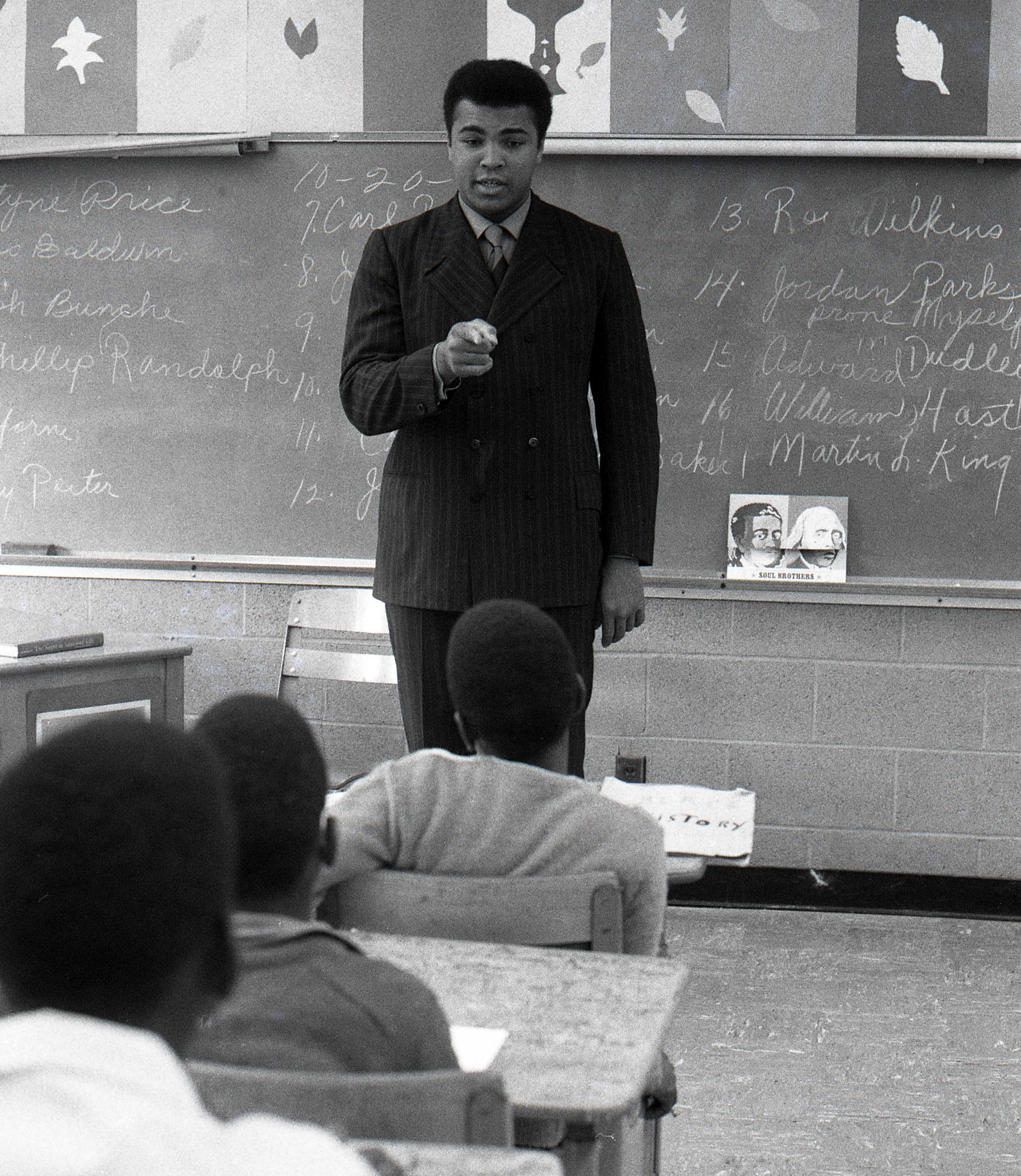 Oct 1969; Louisville, KY; USA: FILE PHOTO; Cassius Clay aka Muhammad Ali speaks with students while visiting DuValle Junior High. Mandatory Credit: The Courier-Journal-USA TODAY Sports